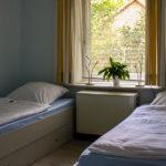 Schlafzimmer mit getrennten Betten: Ferienwohnung in Bad Gandersheim bei Klügers